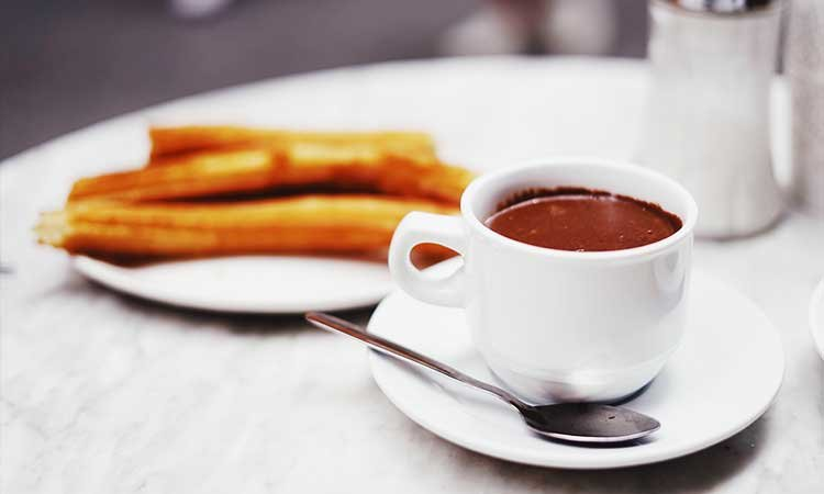 Churros con Chocolate, churros with hot chocolate, typical dessert in Spain